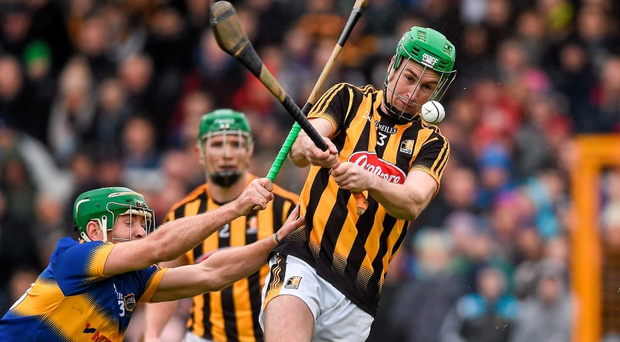 Kilkenny's Joey Holden in action against Noel McGrath at Nowlan Park. Picture credit: Ray McManus / SPORTSFILE