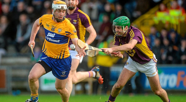 Clare's Conor McGrath takes Shaun Murphy in the Allianz Hurling League encounter at Innovate Wexford Park. Picture credit: Piaras Ó Mídheach / SPORTSFILE