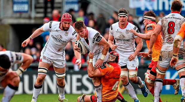 Craig Gilroy, Ulster, is tackled by George Earle, Scarlets