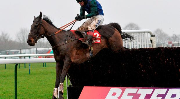 Richard Johnson guides Bishops Road over the final fence on the way to landing Saturday's Grand National Trial Chase at Haydock. Photo: Anna Gowthorpe/PA.