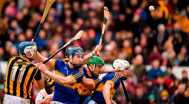 Kilkenny's TJ Reid and Joey Holden in action against (l-r) Tipperary's Tomas Hamill, Cathal Barrett and Michael Cahill in their Allianz NHL clash in Nowlan Park. Photo: Sportsfile