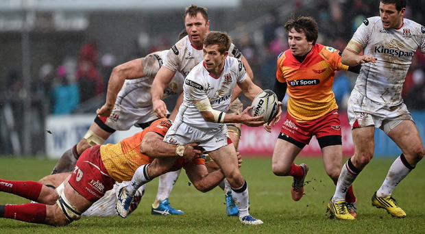 Ulster's Paul Marshall is tackled by Scarlets' George Earle during the match at Ravenhill. Photo: Oliver McVeigh / Sportsfile.