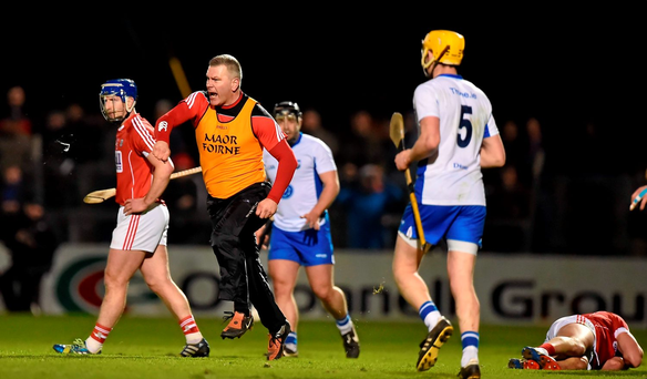 Cork selector Diarmuid O'Sullivan reacts as Aidan Walsh (R) lies injured after being fouled. Photo: Sportsfile