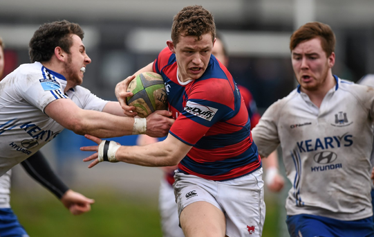 Clontarf's Michael Brown is tackled by Cork Con's Joe White during their Ulster Bank League, Division 1A, clash at Temple Hill, Cork. Photo: Brendan Moran / Sportsfile.