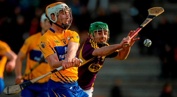 Clare's Conor McGrath under pressure from Wexford's Shaun Murphy during their Allianz NHL clash in Wexford Park. Photo: Sportsfile