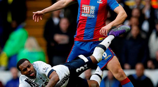 Tottenham Hotspur's Danny Rose (left) is tackled by Crystal Palace's Scott Dann during the Emirates FA Cup, fifth round match at White Hart Lane. Photo: Steve Paston/PA.
