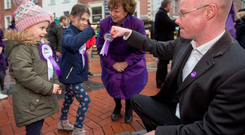Social Democrat co-leaders Catherine Murphy and Stephen Donnelly with sisters Cara (4) and Emma Murphy (6) while canvassing on Grafton Street in Dublin yesterday Photo: Fergal Phillips