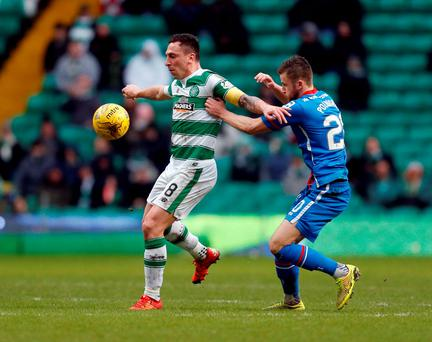 Celtic's Scott Brown (left) and Inverness Caledonian Thistle's Liam Polworth battle for the ball during their Scottish Premiership match at Celtic Park Photo: Danny Lawson/PA.
