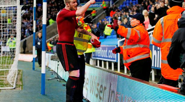 West Brom's Chris Brunt reacts after a coin is thrown at him from the crowd. Photo: Peter Cziborra/Reuters.