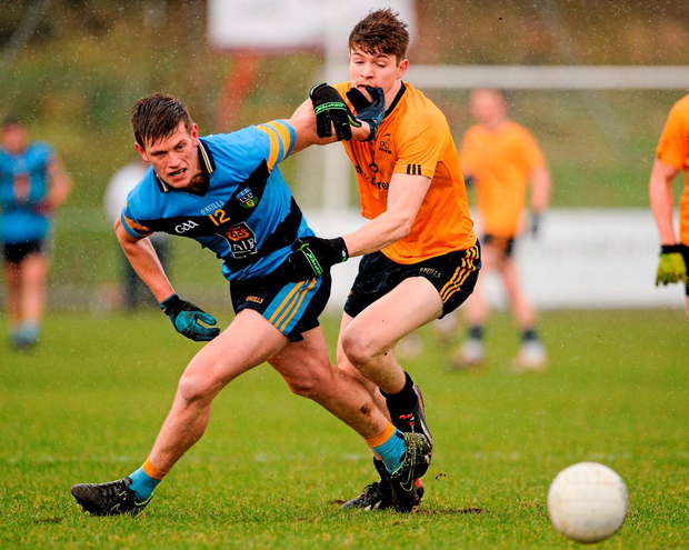 UCD's John Heslin tries to hold off DCU defender Kevin Feely during Saturday's independent.ie Sigerson Cup final. Photo: Sportsfile