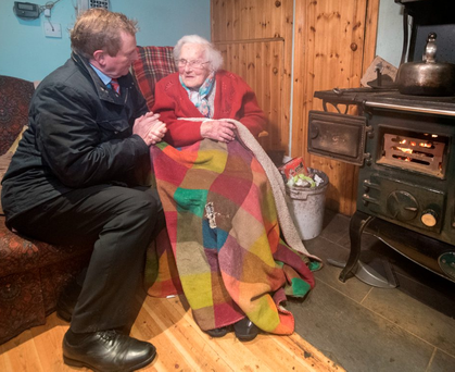 Taoiseach Enda Kenny calls to see Ann 'Nan' Gibson (96) in Kilbaha, Co Clare. Photo: Barry Cronin