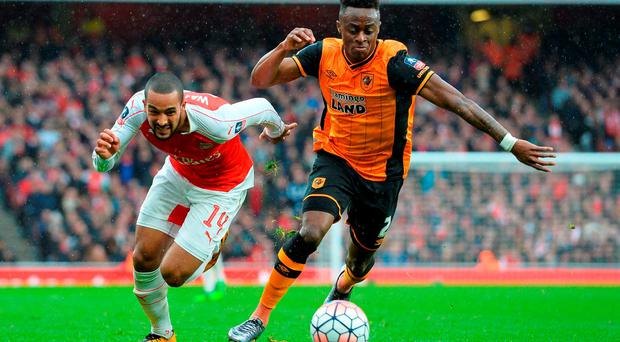 Arsenal's Theo Walcott (L) chases Hull City's defender Moses Odubajo . Photo: Getty
