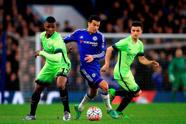 Chelsea's Pedro (centre) battles for the ball with Manchester City's Kelechi Iheanacho (left) and Manu Garcia (right) during the Emirates FA Cup, fifth round match. Photo: John Walton/PA.
