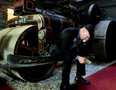 Independent candidate Michael Healy-Rae takes a breather on a steam roller during a visit to Kerry County Council while canvassing in Tralee Photo: Don MacMonagle