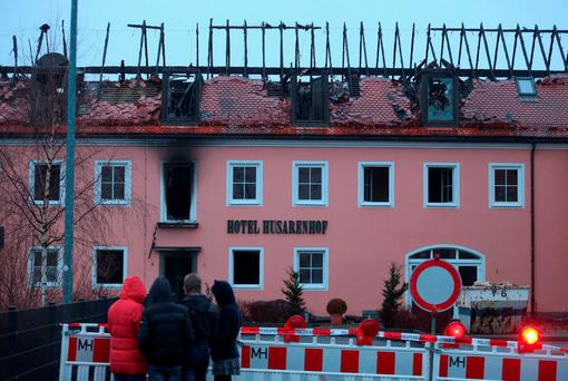 The burnt-out remains of a former hotel in Germany that was to serve as a shelter for asylum-seekers. Photo: Getty