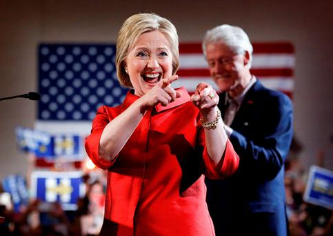 Democratic presidential candidate Hillary Clinton, left, greets supporters with her husband and former President Bill Clinton at a Nevada Democratic caucus rally. (AP Photo/John Locher)