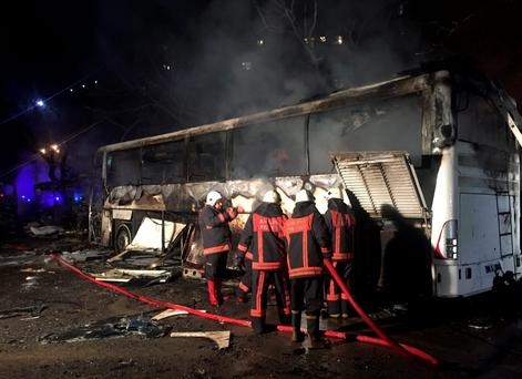 Firefighters work at the scene of an explosion in Ankara, Turkey. (AP Photo)