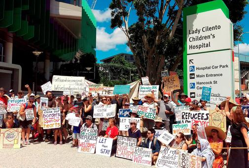 Asylum-seeker advocates gather outside Brisbane's Lady Cilento Children's Hospital in support of one-year-old baby Asha in Brisbane. Reuters/Jamie McKinnell/AAP