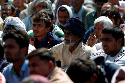 Demonstrators from the Jat community listen to a speaker as they block the Delhi-Haryana national highway during a protest at Sampla village in Haryana, India, February 22, 2016. Reuters/Adnan Abidi