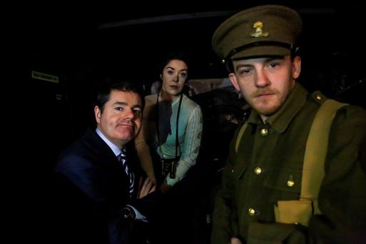 Transport Minister Paschal Donohoe with actors performing in the 1916 Dublin Bus tour