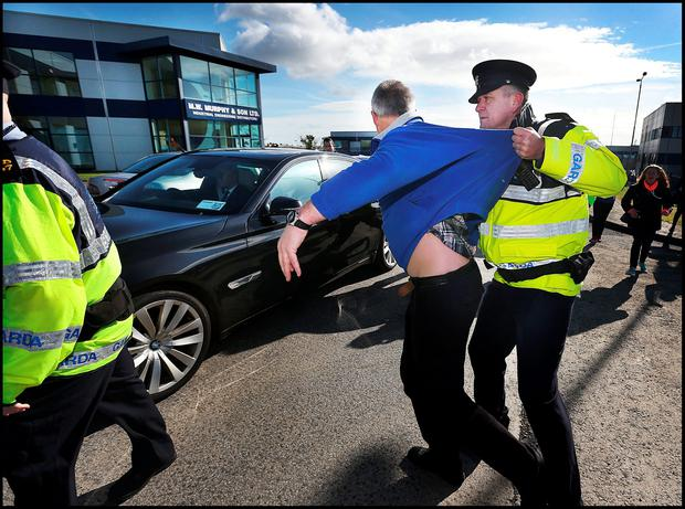 Water protestors try to block Taoiseach Enda Kenny's car as he leaves 'eishtec' in Waterford where he had paid a visit. Pic Steve Humphreys