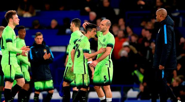 Manchester City's Brandon Barker, Martin Demichelis, David Faupala, Pablo Zabaleta and Vincent Kompany after the final whistle during the Emirates FA Cup, fifth round match at Stamford Bridge