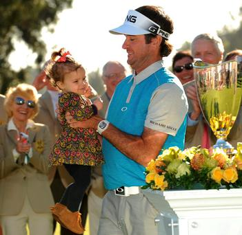 Bubba Watson with daughter Dakota following his victory in the Northern Trust Open at the Riviera Country Club. Photo: Gary A. Vasquez / USA TODAY Sports