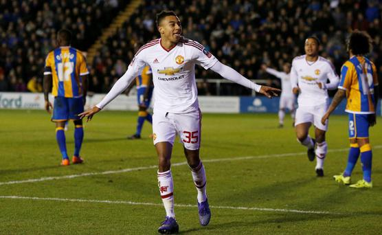 Manchester United's Jesse Lingard celebrates scoring their third goal