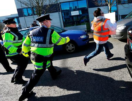 Anti-water charges protesters try to block Enda Kenny's car as he leaves Eishtec. Photo: Steve Humphreys
