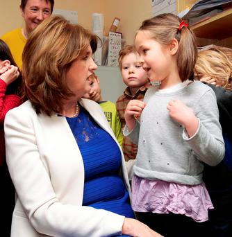 Joan Burton chats to Erin Gallimore at Shellybanks Educate Together National School in Ballsbridge. Photo: Tom Burke