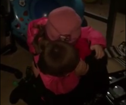 Daniel hugs his sister Abigail after she gives him the gift.