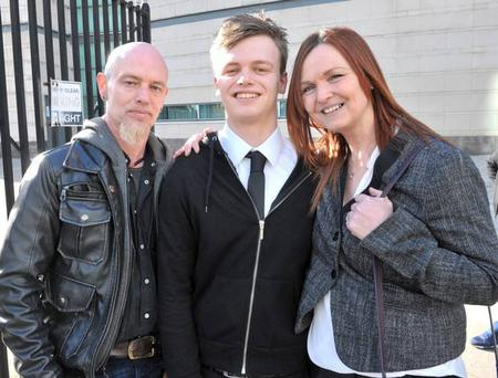 Aodhan Woods leaves court with mum and dad Janice and Sean