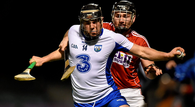 Jake Dillon, Waterford, in action against Colm Spillane, Cork