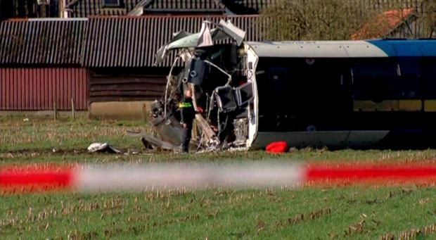 A derailed Dutch passenger train is seen in Dalfsen, Netherlands, in this still image from a video released February 23, 2016. The train derailed on Tuesday after hitting a maintenance crane during rush hour, killing one person and injuring several others, local media reported. REUTERS/NOS via Reuters TV