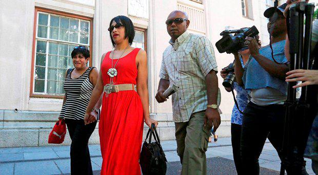 File photo taken on February 27, 2015 shows Celeste Nurse (2nd L), the mother of a South African girl who was abducted after birth in 1997, leaving the Cape Town magistrates' court with family members, after attending a hearing during which a 50-year old woman appeared for allegedly kidnapping Nurse's daughter