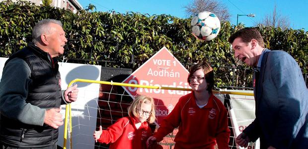 Soccer legend Johnny Giles joined Aodhán Ó Riordáin,TD, the Minister for New Communities,Culture, Equality and Drugs Strategy along with sisters 12 year old Ellen and 8 year old Rose Lindsay-Sherry in a game of street football on Phlipsburgh Avunue,Marino to launch Labour's sport policy.Pic Tom Burke.