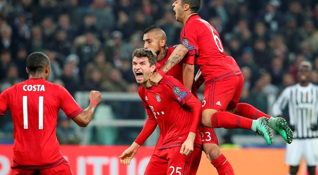 Bayern Munich's Thomas Muller (2nd L) celebrates after scoring against Juventus.