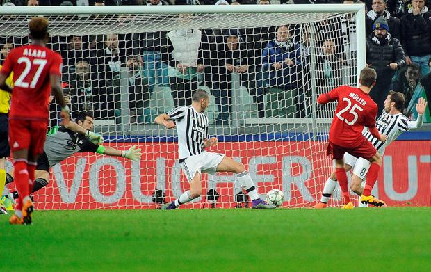 Bayern Munich's Thomas Muller scores against Juventus.