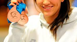 Grainne Murphy with her two bronze medals from the European Short Course Swimming Championships in 2010. Brendan Moran / SPORTSFILE