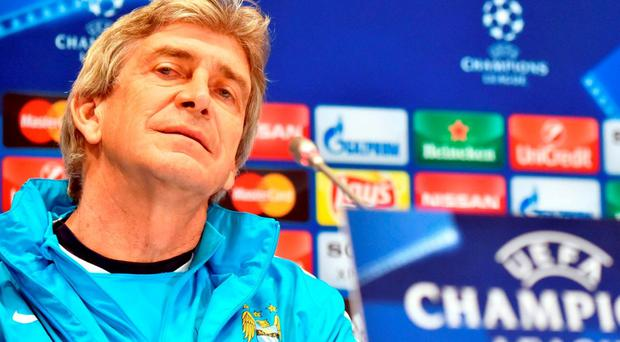 Manuel Pellegrini in relaxed mood in Kiev yesterday ahead of tonight's Champions League showdown. SERGEI SUPINSKY/AFP/Getty Images