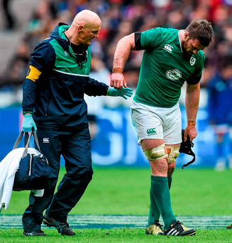 Sean O'Brien, leaves the field with team doctor Dr. Jim McShane after picking up an injury during the match against France. Photo: Ramsey Cardy / Sportsfile.