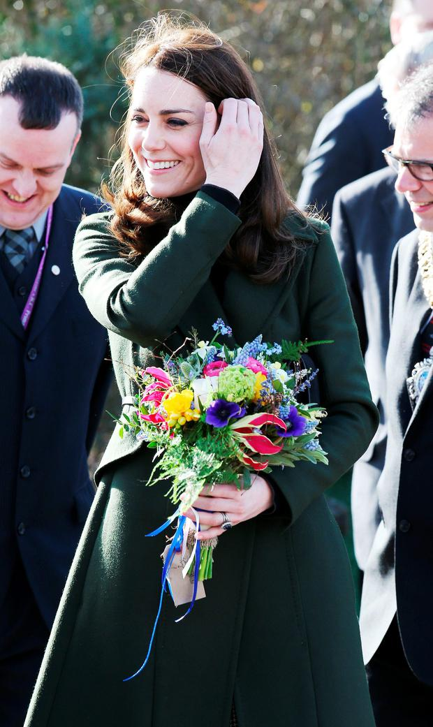 Catherine, Duchess of Cambridge is presented with a bunch of flowers during a visit to the Place2Be charity at Catherine's Primary School on February 24, 2016 in Edinburgh, Scotland. (Photo by Andrew Milligan - WPA Pool/Getty Images)