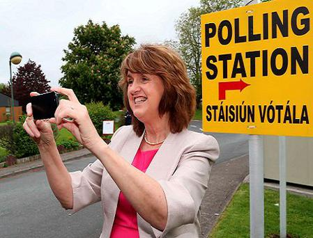While it's advisable to check at polling stations before bringing your dog on election day, taking a selfie with your ballot paper is a no-no, though not specifically covered under Irish electoral law. Photo: Collins