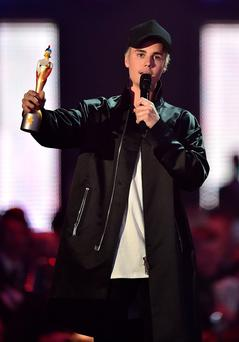 Justin Bieber wins the International Male Solo award during the 2016 Brit Awards at the O2 Arena, London. Photo: Dominic Lipinski/PA Wire