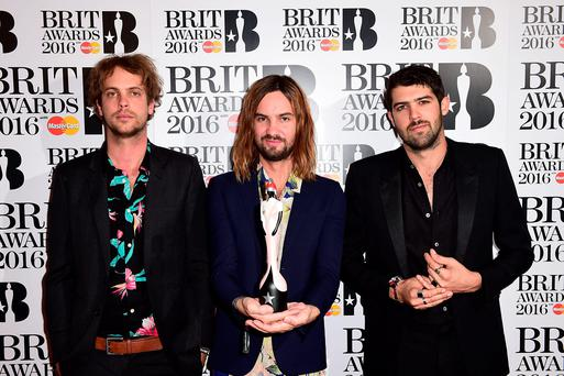 (Left to Right) Jay Watson, Kevin Parker and Cam Avery of Tame Impala with the BRIT Award for Best International Group in the press room at the 2016 Brit Awards at the O2 Arena, London. Photo: Ian West/PA Wire