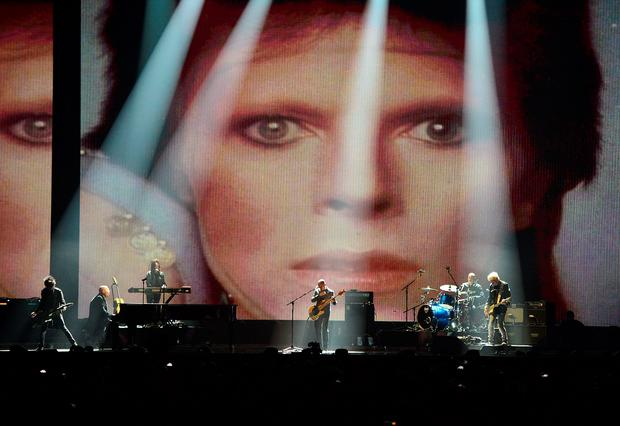 David Bowie's band performs on stage during the 2016 Brit Awards at the O2 Arena, London. Photo: Dominic Lipinski/PA Wire