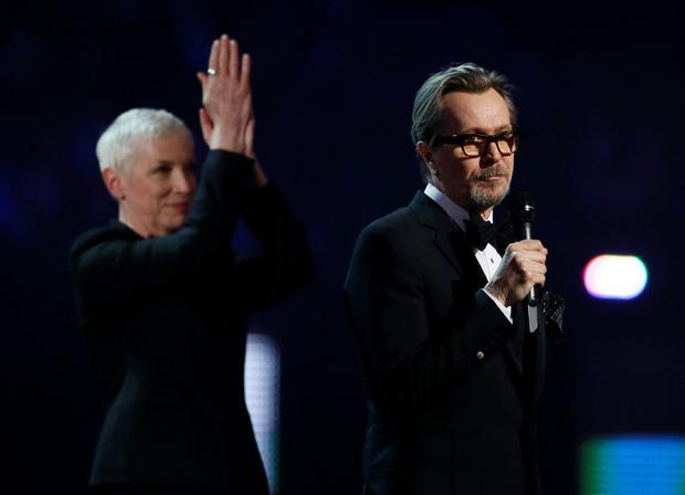 Gary Oldman and Annie Lennox make a tribute to David Bowie at the BRIT Awards in the O2 arena in London, February 24, 2016. REUTERS/Stefan Wermuth