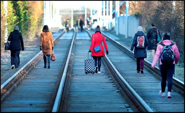 Commuters walking along the Luas tracks at Ranelagh following strike. Photo: Steve Humphreys