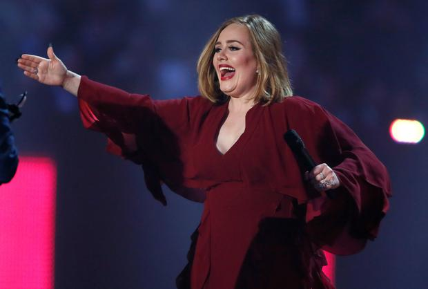 Adele reacts as she arrives to accept the award for best British single at the BRIT Awards at the O2 arena in London, February 24, 2016. REUTERS/Stefan Wermuth EDITORIAL USE ONLY