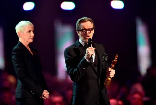 Gary Oldman collects the Brits Icon award for David Bowie on stage during the 2016 Brit Awards at the O2 Arena, London last night
